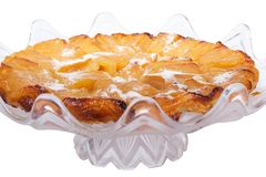 French apple pie. Tatina French apple pie with caramel and powdered sugar Royalty Free Stock Photo