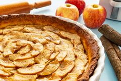 Free French Apple Tart Aside Gala Apples, Cinnamon Sticks And A Rolling Pin On A Light Blue Background. Side View Stock Images - 189879864
