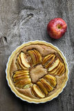 French Apple Tart Cake Sweet Dessert Pie. French apple tart sweet cake in white desert pie backing tray on old elm wooden table Stock Photography