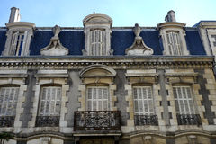 French architecture. Classic facade of french apartment building Royalty Free Stock Image