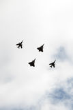 French army aircrafts. Four french army aircrafts passing by in the sky : two Rafale and two Super Étendards planes Royalty Free Stock Images