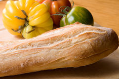 French baguette. Fresh baked french baguette with heirloom tomatoes Stock Photos