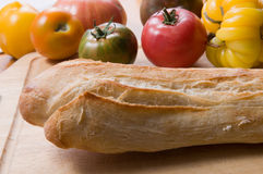 French baguette. Fresh baked french baguette with heirloom tomatoes Royalty Free Stock Image