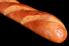 French baguette on a black background Stock Images