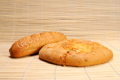 French baguette and Bread with cheese. French baguette and Round flat Bread with cheese Stock Photography