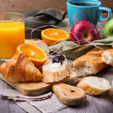 French baguette with butter and jam for breakfast Stock Images
