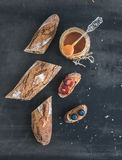 French baguette cut into pieces, sandwiches with red grapes, blu Stock Photography