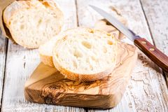 French Baguette on cutting board Royalty Free Stock Photos