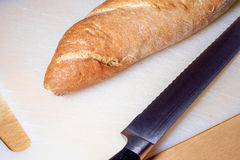 French baguette and knife Stock Images