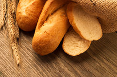 French baguette sliced on the wooden desk Royalty Free Stock Images