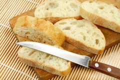 French baguette on a wooden table Royalty Free Stock Photos