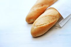 French baguettes, loaves on a light wooden background. Bakery and fresh bread concept royalty free stock photos