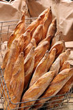 French baguettes in metal basket in bakery Stock Image