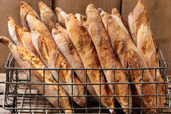 French baguettes in metal basket in bakery Stock Photography