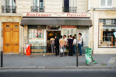 French Bakery. A line outside a bakery in Paris Royalty Free Stock Image