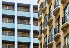 French balconies contrasting with the postmodern architecture of blue balconies Royalty Free Stock Photography