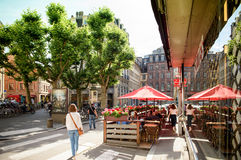 French Bar Chez marco in Central Strasbourg. STRASBOURG, FRANCE - JUL 4, 2016: Woman walking near Chez Marco`s Bar Cintra in central Strasbourg waiting for stock image