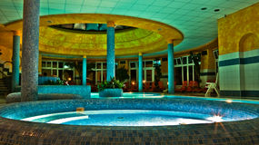 French bathhouse. A beautiful French bathhouse at night Royalty Free Stock Image