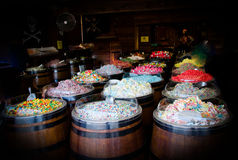 French bazaar with wide selection of candy area inside of wooden barrels Stock Photo