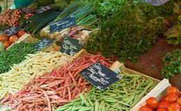 French beans at Provence market. French beans and some other vegetables on market table of small Provence town, south France Royalty Free Stock Image