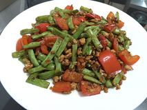 French beans. And red chili peppers sautéed with minced meat in garlic and oyster sauce Royalty Free Stock Photo