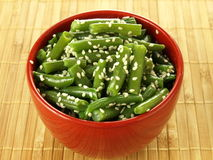 French beans with sesame. Bowl of boiled french beans with sesame grains Royalty Free Stock Images