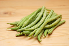 French Beans on a wooden surface Royalty Free Stock Images