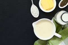 French Bechamel Sauce. Homemade French Bechamel or White Sauce served in sauce boat with ingredients on the side flour, butter, milk, pepper, photographed stock images