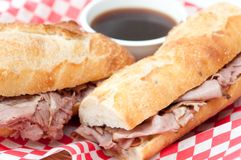 French beef dip sandwich au jus Royalty Free Stock Photos