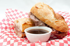 French beef dip sandwich au jus Stock Photography