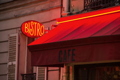 French Bistro Sign and Awning. The red sign and awning of a typical Parisian bistro Royalty Free Stock Photos
