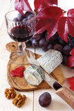 French blue cheese, walnuts, grapes and a wineglass Royalty Free Stock Photos