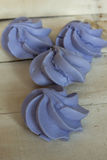 French blue meringue cookies on wooden background Stock Photography