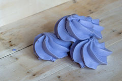 French blue meringue cookies on wooden background Stock Photos