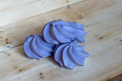 French blue meringue cookies on wooden background Royalty Free Stock Photography