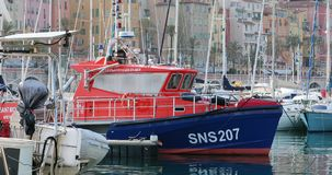French Blue And Orange Boat Rescuers At Sea Moored on The Harbor. Menton, France - March 31, 2018: Boat Rescuers At Sea Les Sauveteurs En Mer in French Moored on stock video footage