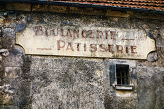 French Boulangerie and Patisserie Bake Shop Sign. Boulangerie and patisserie French antique bakery and pastry shop old and distressed store sign hanging on a Royalty Free Stock Photo