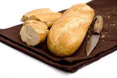 French bread. With brown napkin and white background Stock Photos