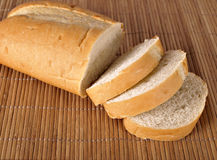 French Bread. A loaf of French Bread on a place mat stock photo