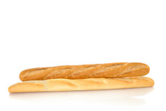 French bread, baguette. Freshly  baked white and whole wheat French baguette bread  photographed on reflective surface, blank background Stock Photo