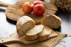 French bread baguette cut on wooden board with knife. with a cho Royalty Free Stock Photos
