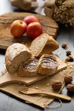 French bread baguette cut on wooden board with knife. with a cho Royalty Free Stock Image