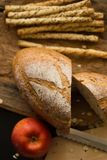 French bread baguette cut on wooden board with knife. with a cho Stock Image