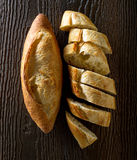 French Bread Baguettes. Freshly baked french bread baguettes on a rustic wood table Stock Photos