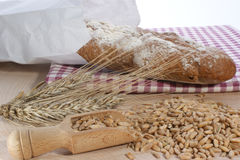French bread with cereals on timber plate Stock Images