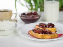 The French bread fried and slathered with plum jam. Stock Images