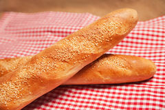 French bread isolated on checkered napkin Stock Photo