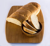 French Bread Loaf on Cutting Board Stock Image