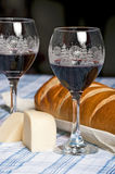 French bread wine glasses and cheese wedge for Christmas Royalty Free Stock Photography