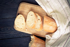 French bread on the wooden table Royalty Free Stock Image